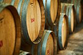Wine Barrels Stacked In The Old Cellar Of The Winery. poster