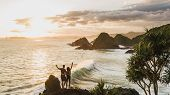 Couple Enjoying Sunset With Amazing Ocean And Mountain View. Travel Concept, Panoramic Shot, Wanderl poster