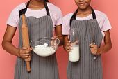 Cropped Image Of African Sisters Holding Kitchen Tools, Flour And Milk, Kids And Cooking Concept, Re poster