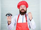 Meticulous Preparation And Careful Presentation Meal. Man Hat And Apron Hold Meal Covered With Lid.  poster