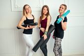 Happy Group Of People Three Women Practicing Yoga In Fun In The Studio. Groups Of Meditation And Sup poster