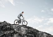 Businessman Riding Downhill By Bike. Nature Landscape With Copy Space. Man In Business Suit Riding B poster
