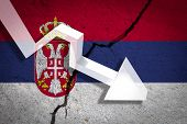 Serbia Flag On The Cracked Wall With Arrow Falling Down. Concept Of Decrease In The Country. poster