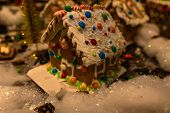 Christmas Decorations Against Blurred Background. Ginger House With Candies. Roof Of Ginger House Fu poster