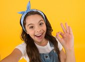 Its Ok. Happy Little Child With Ok Hand On Yellow Background. Small Girl Smiling With Ok Gesture. Ok poster