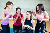 A Group Of Four Women Are On A Diet On Mats In The Gym. The Concept Of Group Therapy In Womens Suppo poster
