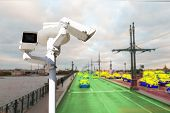 The Concept Of Video Surveillance And Security Technology. A Surveillance Camera Monitors The Violat poster