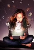 picture of tablet pc computer  - Surprised girl with tablets in hand - JPG