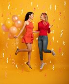 Girls Ready For A Party With Balloons. Joyful An Happiness Expression. Yellow Background poster