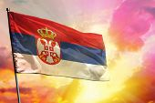 Fluttering Serbia Flag On Beautiful Colorful Sunset Or Sunrise Background. Serbia Success And Happin poster