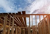 New Low Apartments Building Construction Residential Construction House Framing A Blue Sky poster