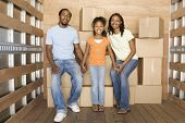 image of nuclear family  - African family in back of moving truck - JPG