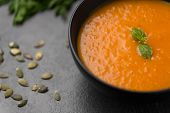food, new nordic cuisine, culinary and cooking concept - close up of vegetable pumpkin cream soup in poster