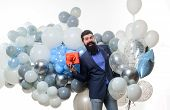 Happy Birthday Guy Holds Helium Balloons And Gift Box. People, Joy, Birthday, Celebration. Festive E poster