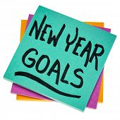 New Year goals - handwriting on an isolated sticky note, planning and rersolutions concept poster