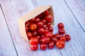 Organic Ripe Cherry Tomatoes In A Recyclable Paper Box On A Wooden Table. Cooking Ingredients. Harve poster