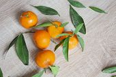 Tangerines Food Background. Healthy Food. Vegetarian Food. Vegetable Food. Food Tangerines With Gree poster