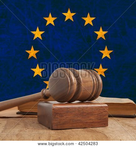 Wooden gavel and vintage Europe flag