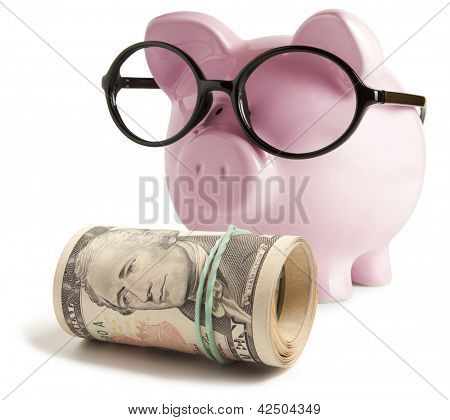 Piggy bank with glasses isolated