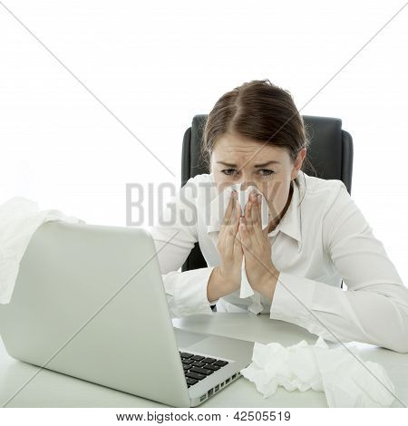 Young Brunette Business Woman Is Ill With Hankies Behind Her Laptop