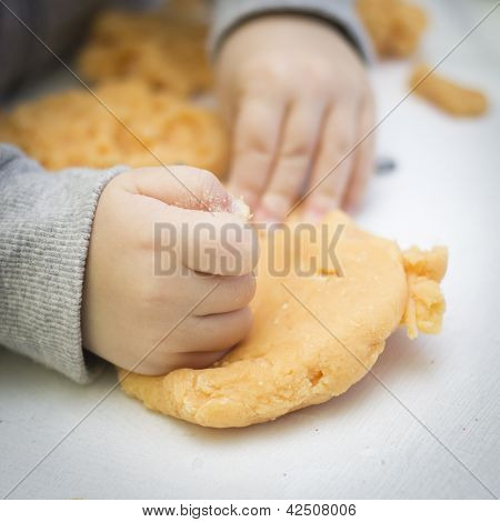 Young Boy Playing With Playdough