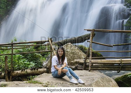 Girl And Beautiful Waterfall In Northern Thailand