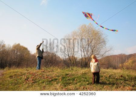Grandfather And The Grandson Start A Kite