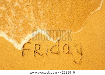 Friday - written in sand on beach texture - soft wave of the sea (days week series)