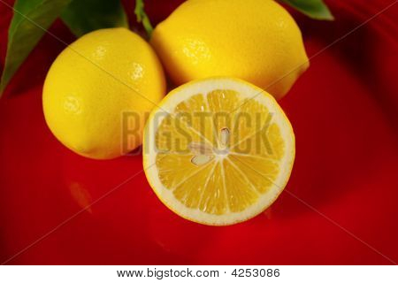 Close Up Of Lemons On A Red Plate