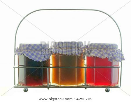 Traditional Jam-jars In A Wire Rack