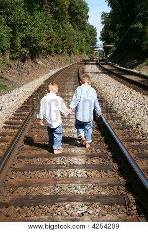 Boys Walking Railroad Tracks