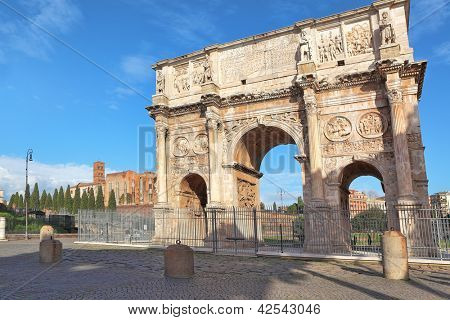 Famous Arch of Constantine aka triumphal arch and Santa Francesca Romana church on Palatine hill in Rome, Italy.