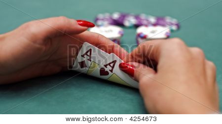 Playing cards in hands