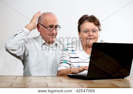 Old Couple With Laptop