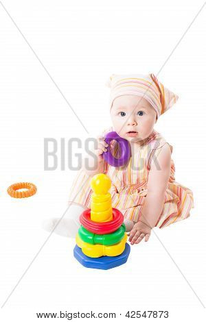 Baby Girl Playing With  Toy Pyramid Build From Rings Isolated On White Background.toy For Children A