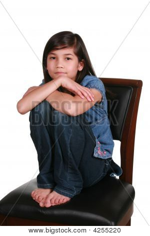 Little Girl Sitting On Bar Stool