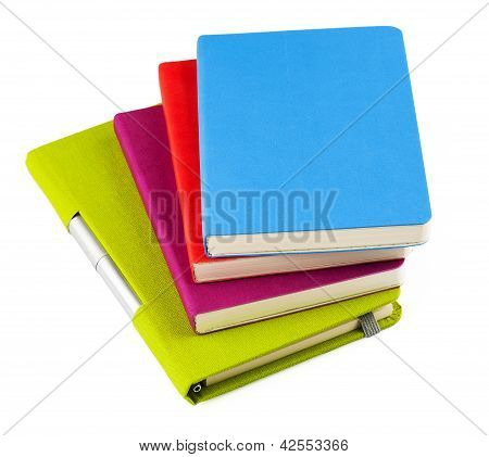 Colourful Notebooks With Ballpoint Pen