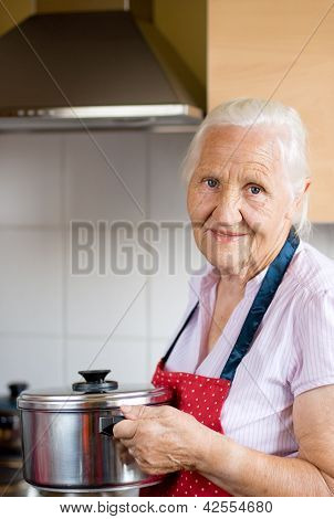 Smiling senior woman in a kitchen