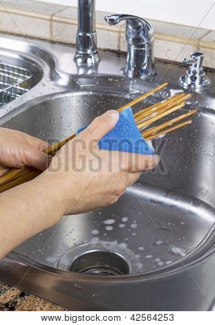 Female Hands Cleaning Chopsticks