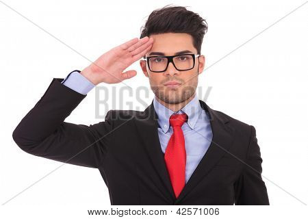 portrait of a young business man saluting and looking at the camera on white