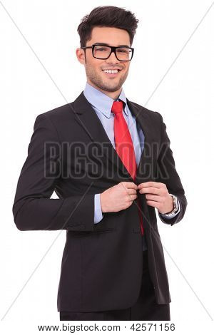 picture of a young business man buttoning his coat on white background