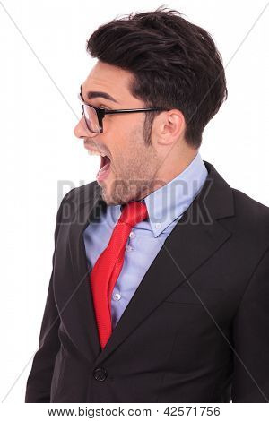 closeup portrait of a young business man looking shocked to his side with his mouth wide opened, isolated on white
