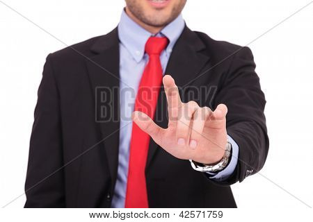 Portrait of young business man touching an imaginary screen against white background