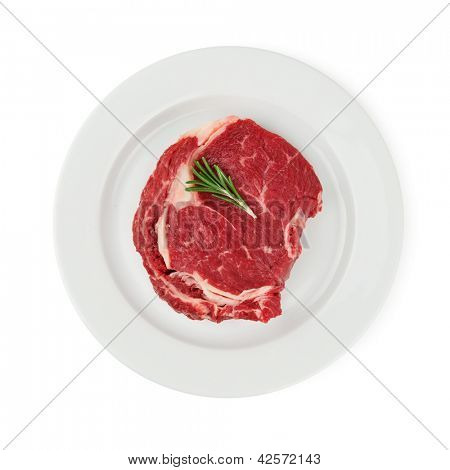 steak with twig of rosemary isolated