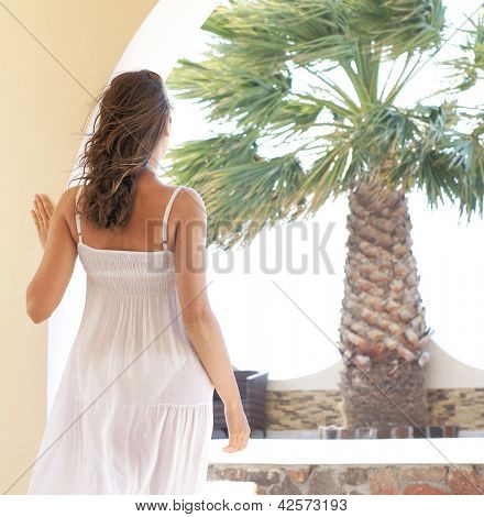 Young attractive woman chilling at the tourist resort