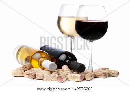 Glasses Of White And Red Wine And Corks Over White