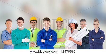 Group of people with different jobs standing with arms folded in line