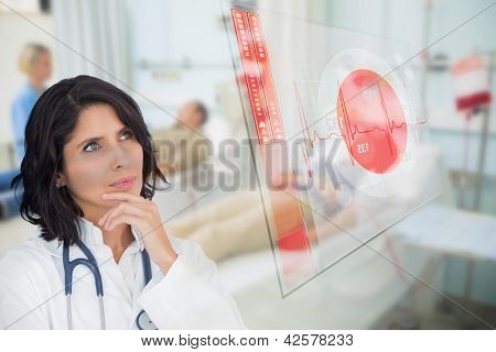Doctor studying virtual screen showing ECG line