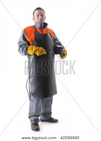 Portrait of welder wearing protective welding black leather apron, welding hood and welding electrode holder over white
