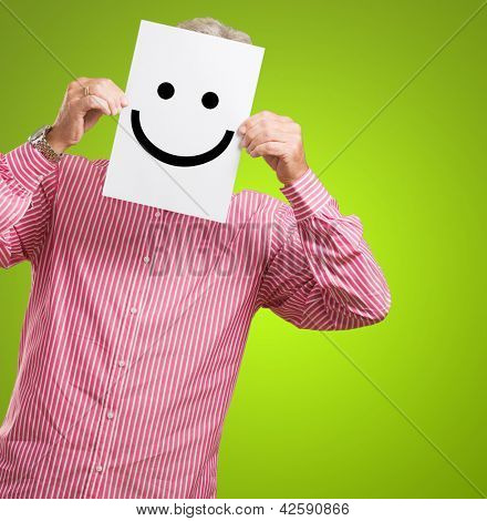 Man Hiding His Face Behind Paper On White Background
